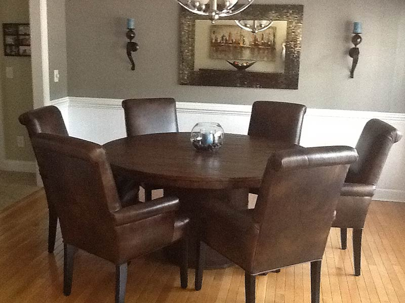 these leather tisbury arm chairs encircling this round table give this dining room a masculine feel - Dining Room Chairs With Arms
