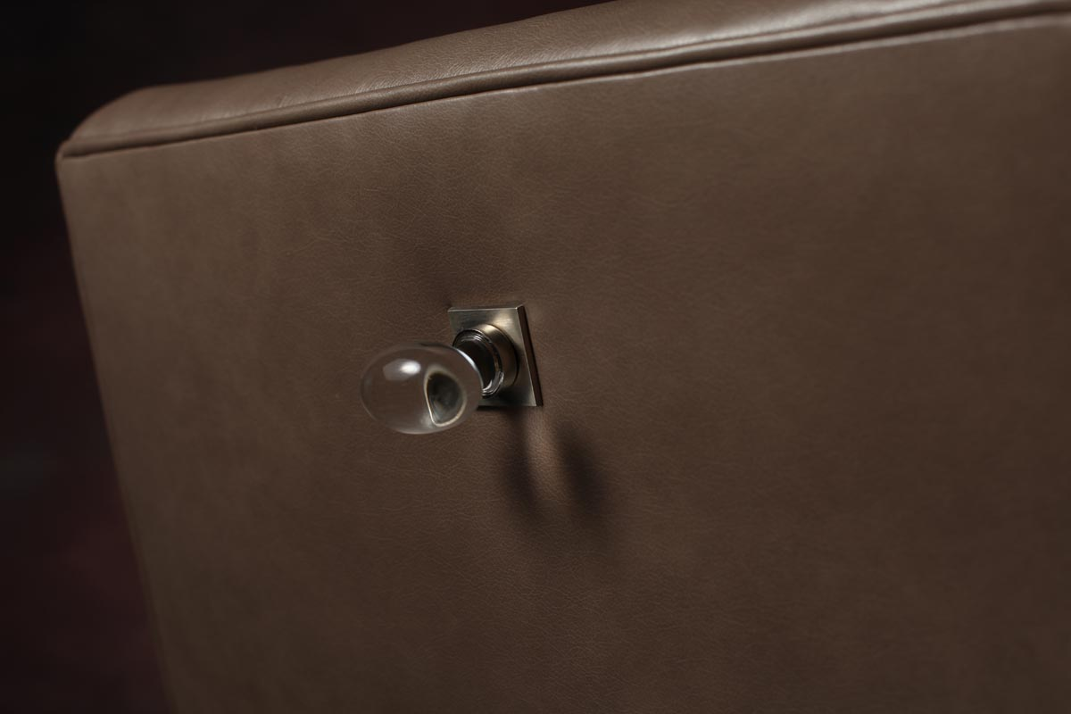 Close up of knob-type drawer pull on an Parsons Dining Chair